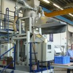 Laboratory test stand in the screening laboratory of Haver Niagara with a Fine-Line screening machine for fine powders