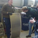 A man demonstrates new screen coverings from Haver Niagara in front of students with special mesh geometries and coverings for demanding screening materials